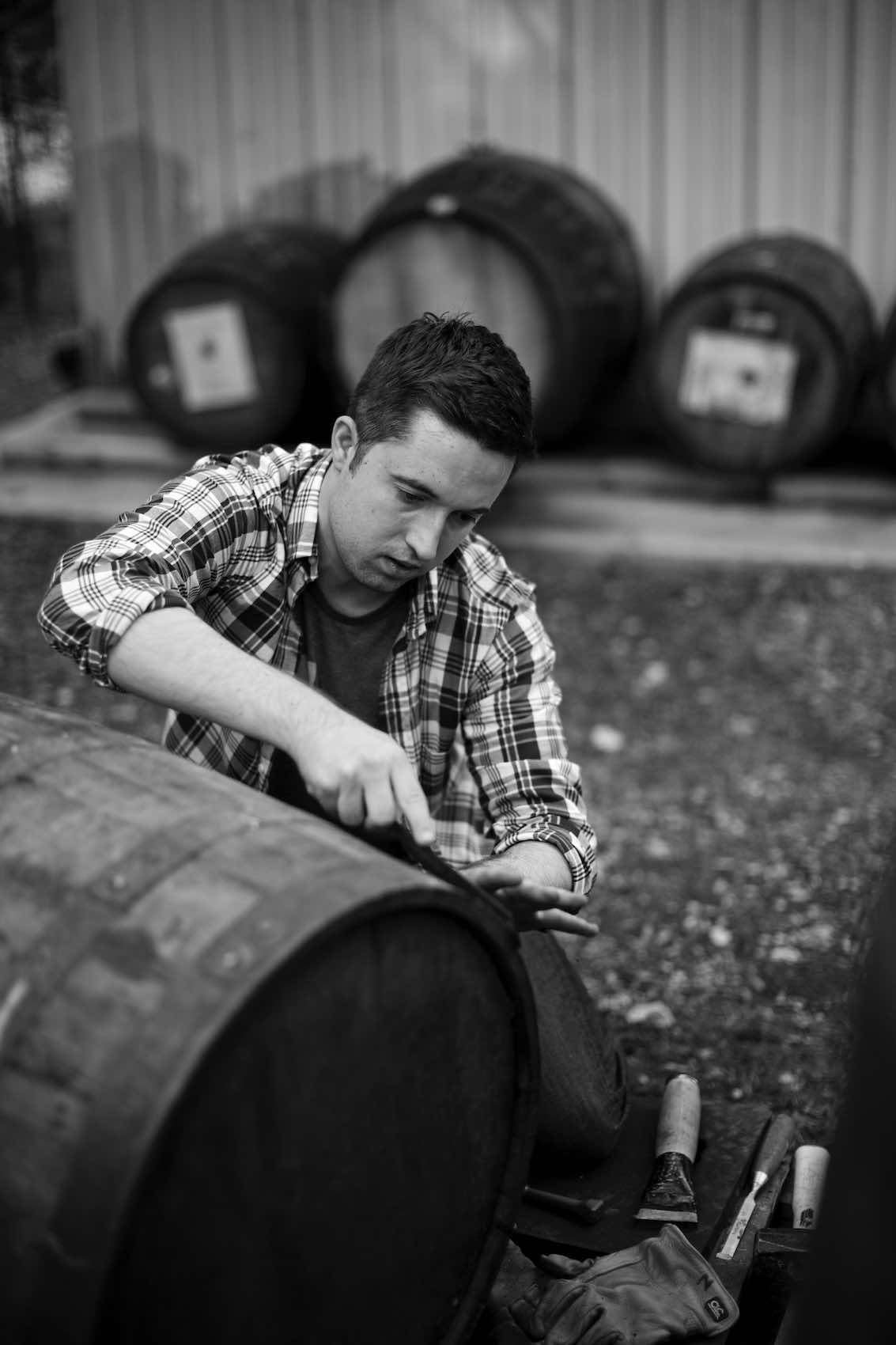 Jody Horton Photography - Worker crafting a wood barrel, shot in B&W.