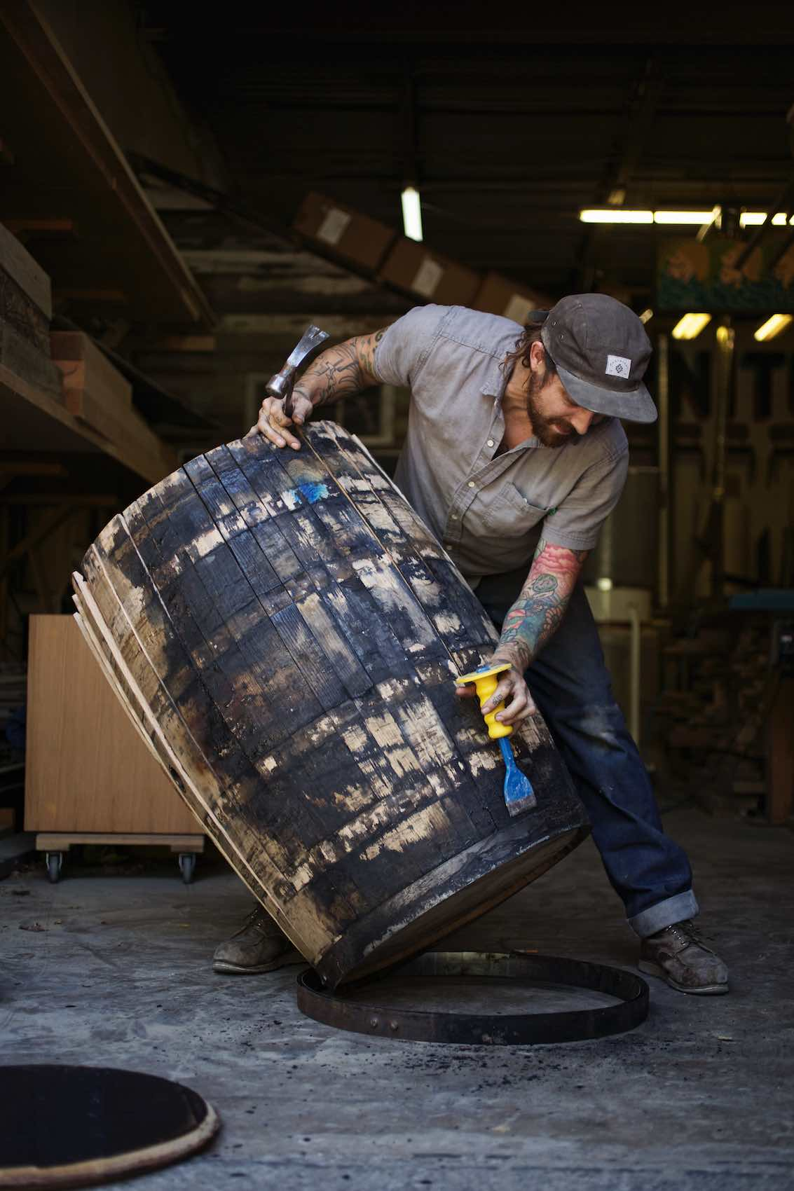 Jody Horton Photography - Man breaking down wood barrel.