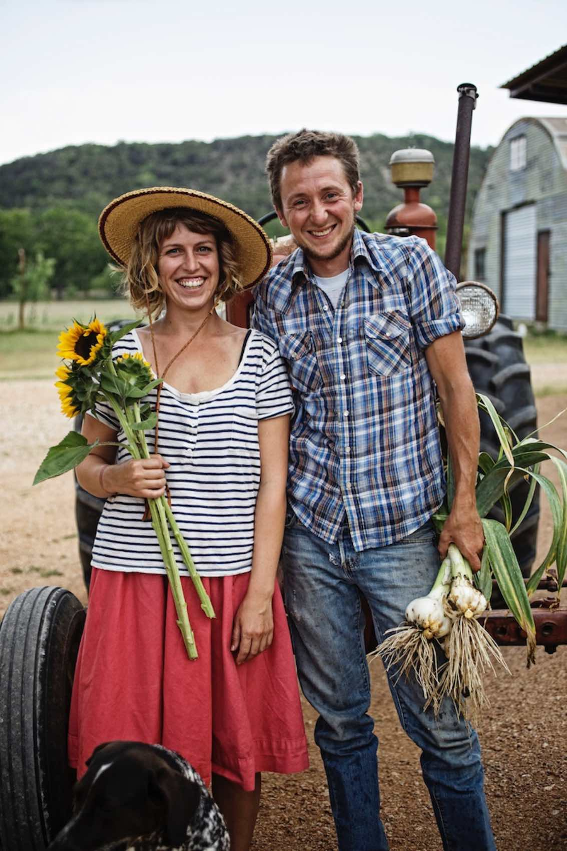 Jody Horton Photography - Farmers pose with sunflowers and green onions.