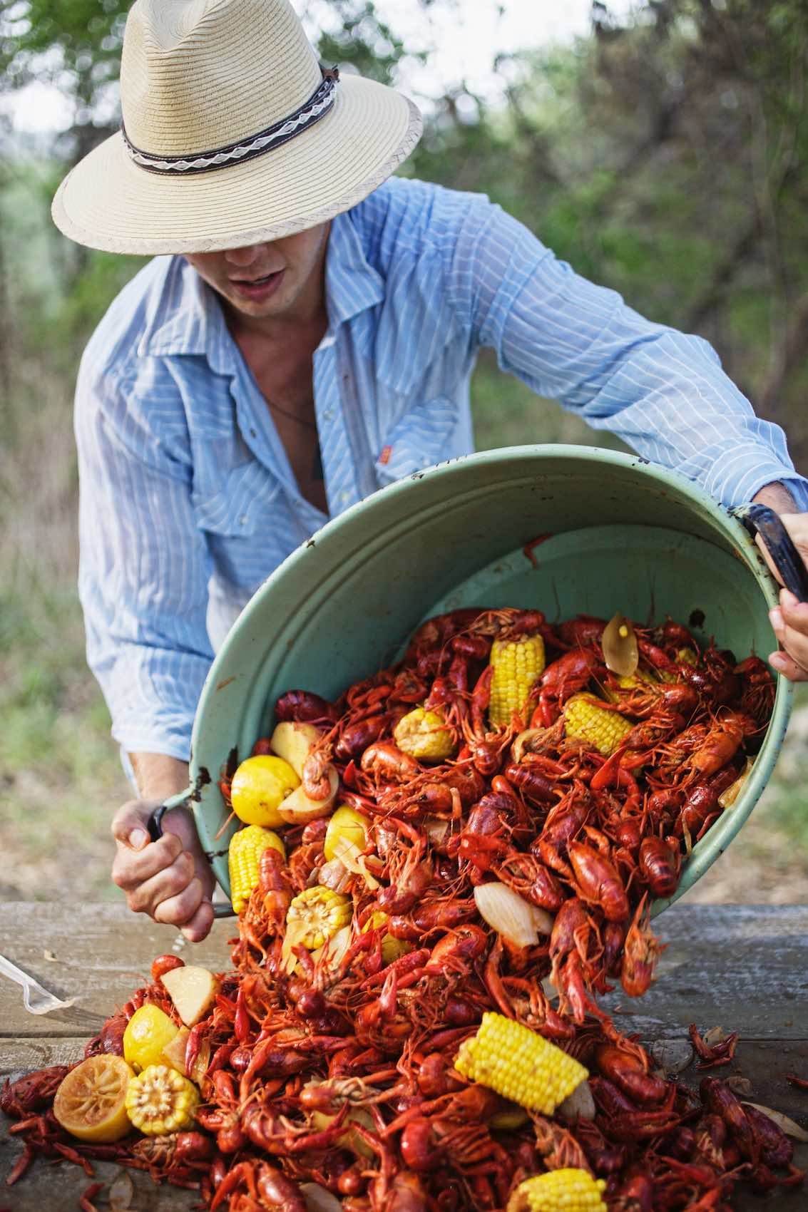 Jody Horton Photography - Crawfish boil spread onto picnic table.