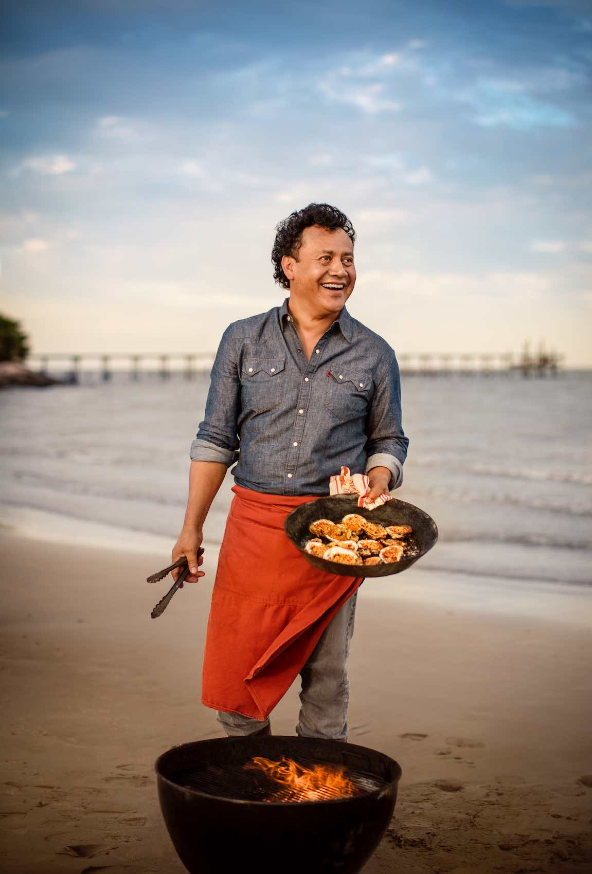 Jody Horton Photography - Chef grilling oysters on the beach.
