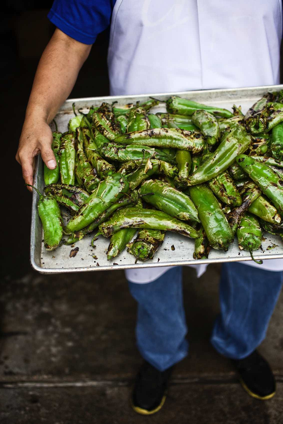 Jody Horton Photography - Roasted poblano peppers on metal sheet tray.