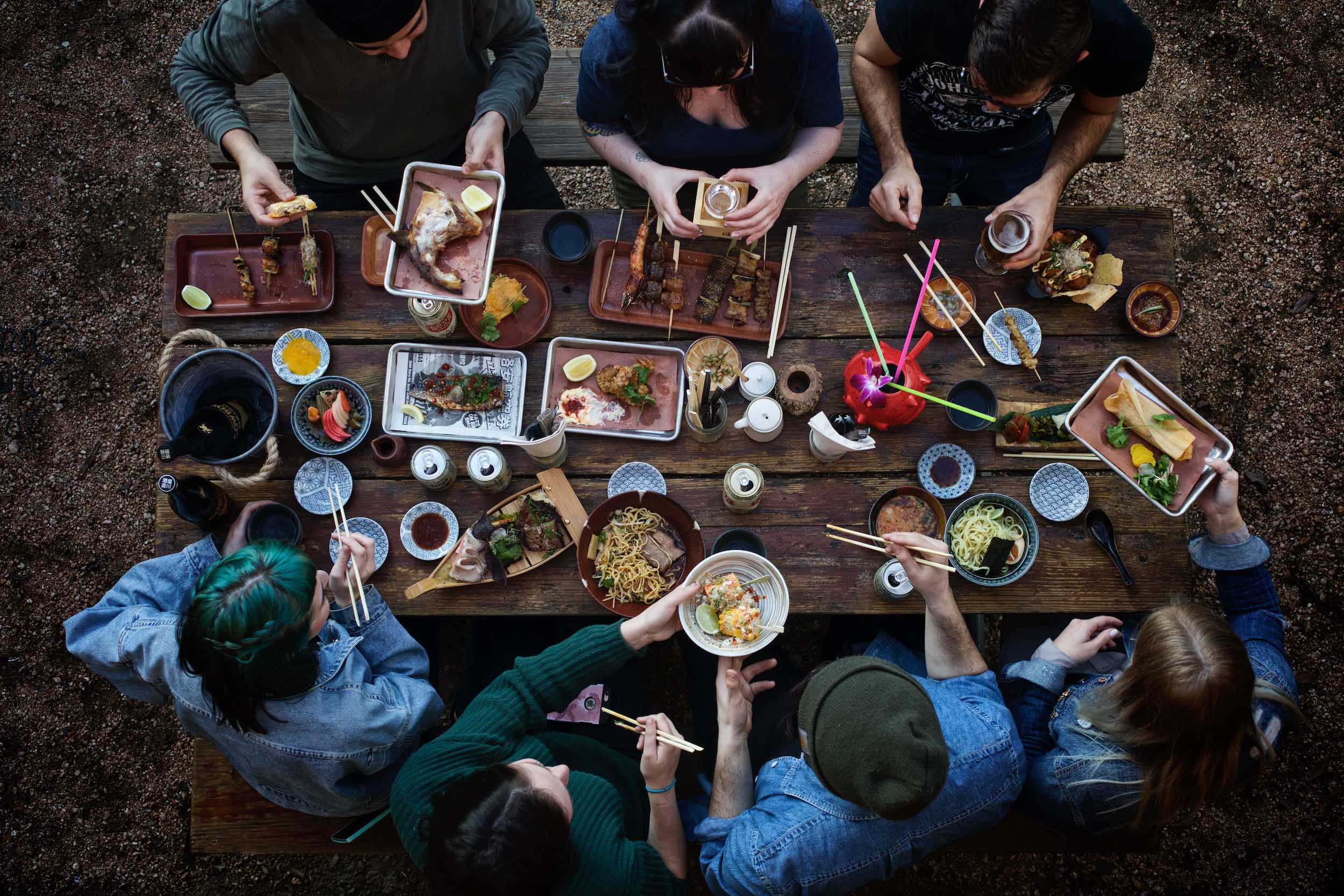 Jody Horton Photography - Outdoor picnic spread on wood table.