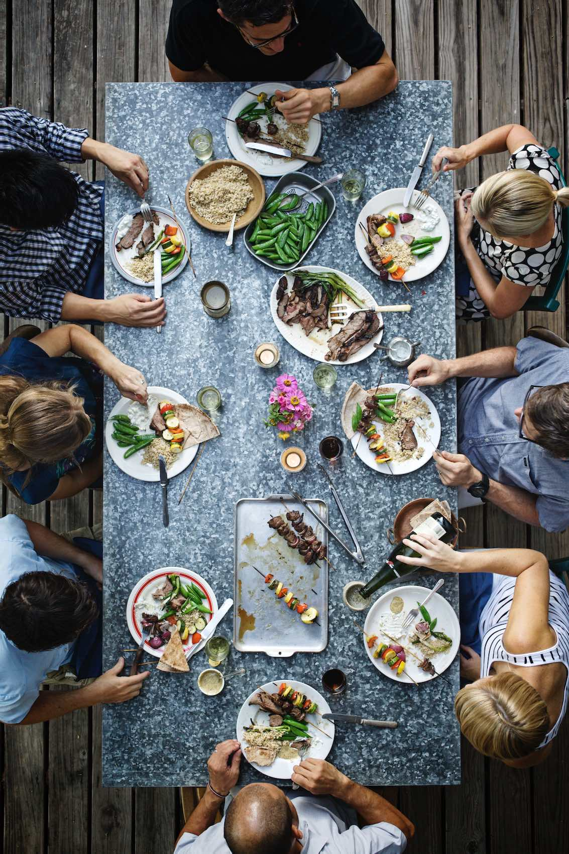 Jody Horton Photography - Outdoor dinner spread on granite table.