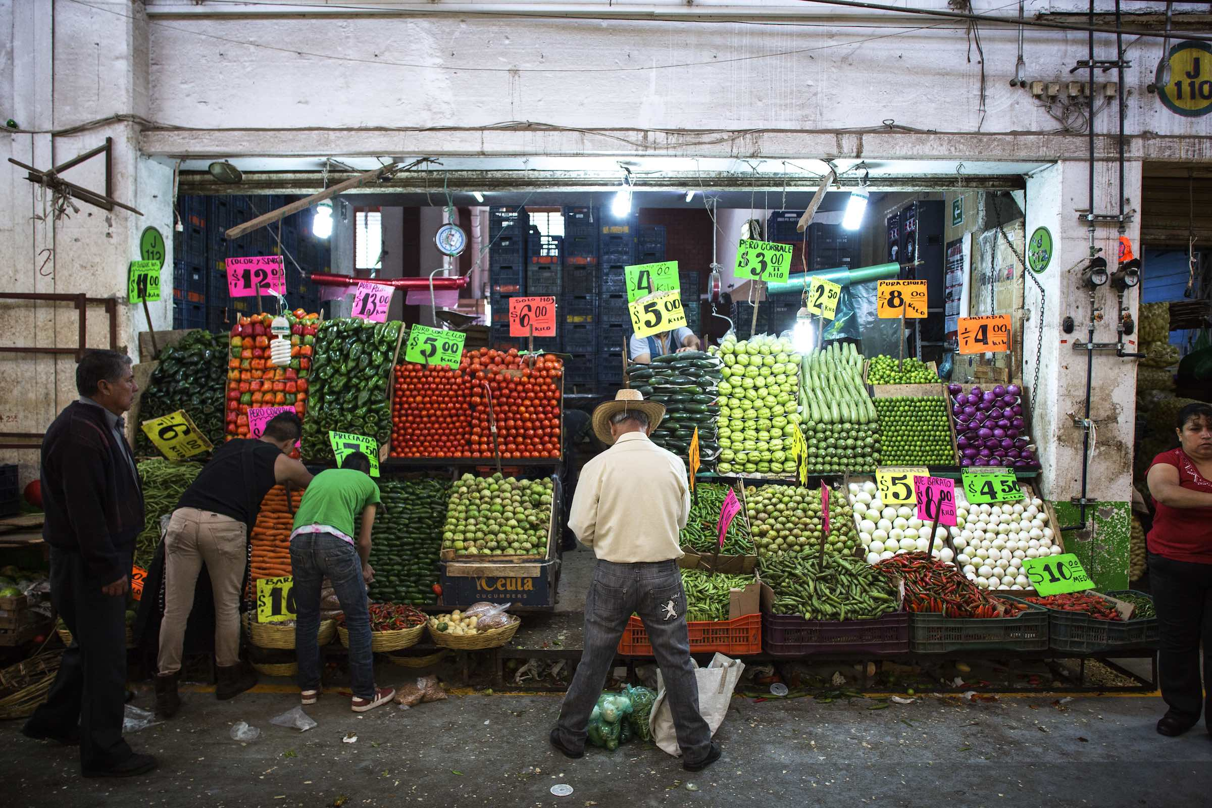 Jody Horton Photography - Patrons buying colorful produce from a street vendor.