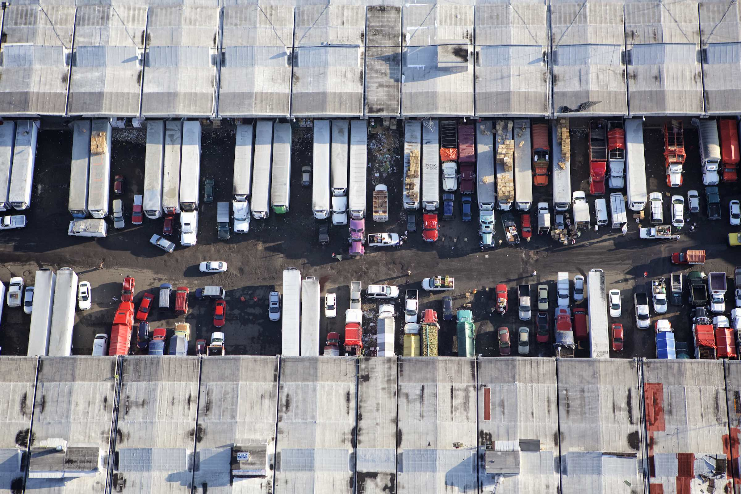 Trucks unloading goods at the food market in Mexico.