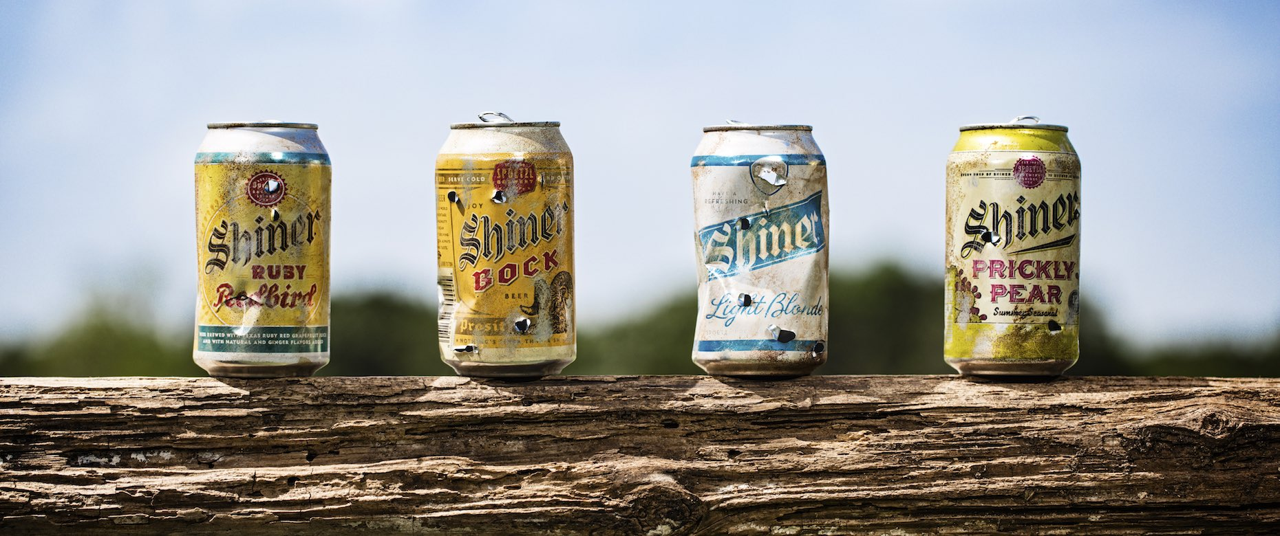 Worn Shiner beer cans used for target practice.
