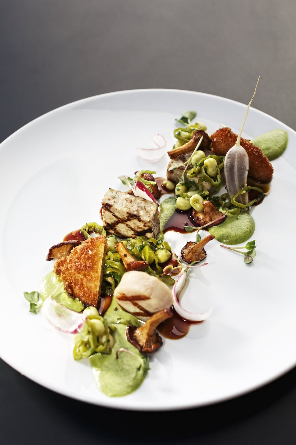 Vibrant vegetable dish presented on a large white plate.