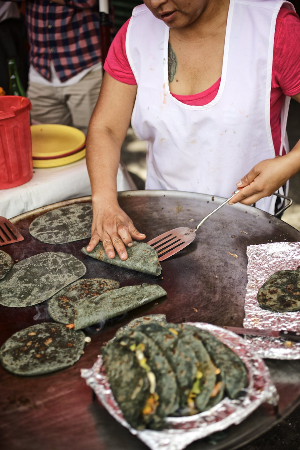 Chef preparing blue corn tacos on a Plancha.