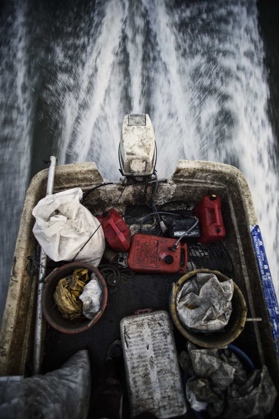 Jody Horton Photography - Speed boat with fishing gear moving along dark water.