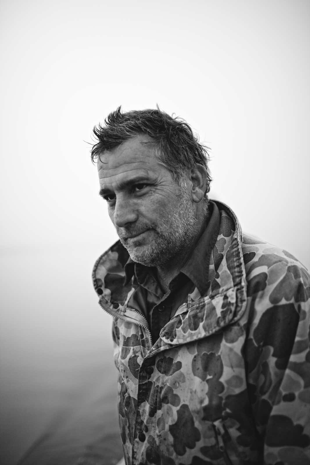 Fisherman shot in B&W during oyster harvest.