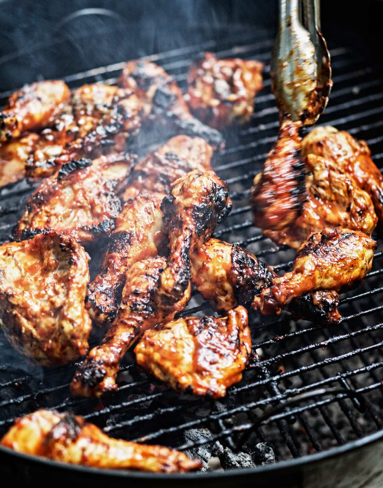 Jody Horton Photography - Chicken wings cooking on grill.