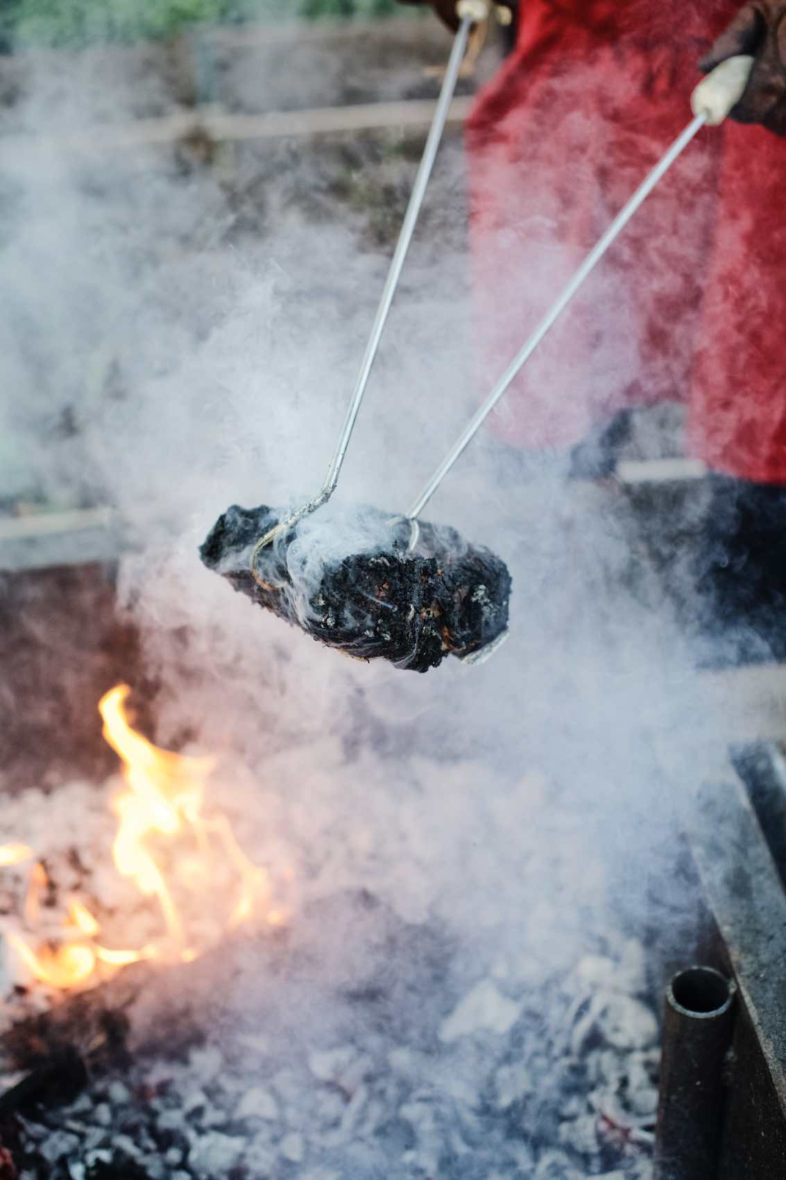 Jody Horton Photography - Blackened meat pulled from fire.