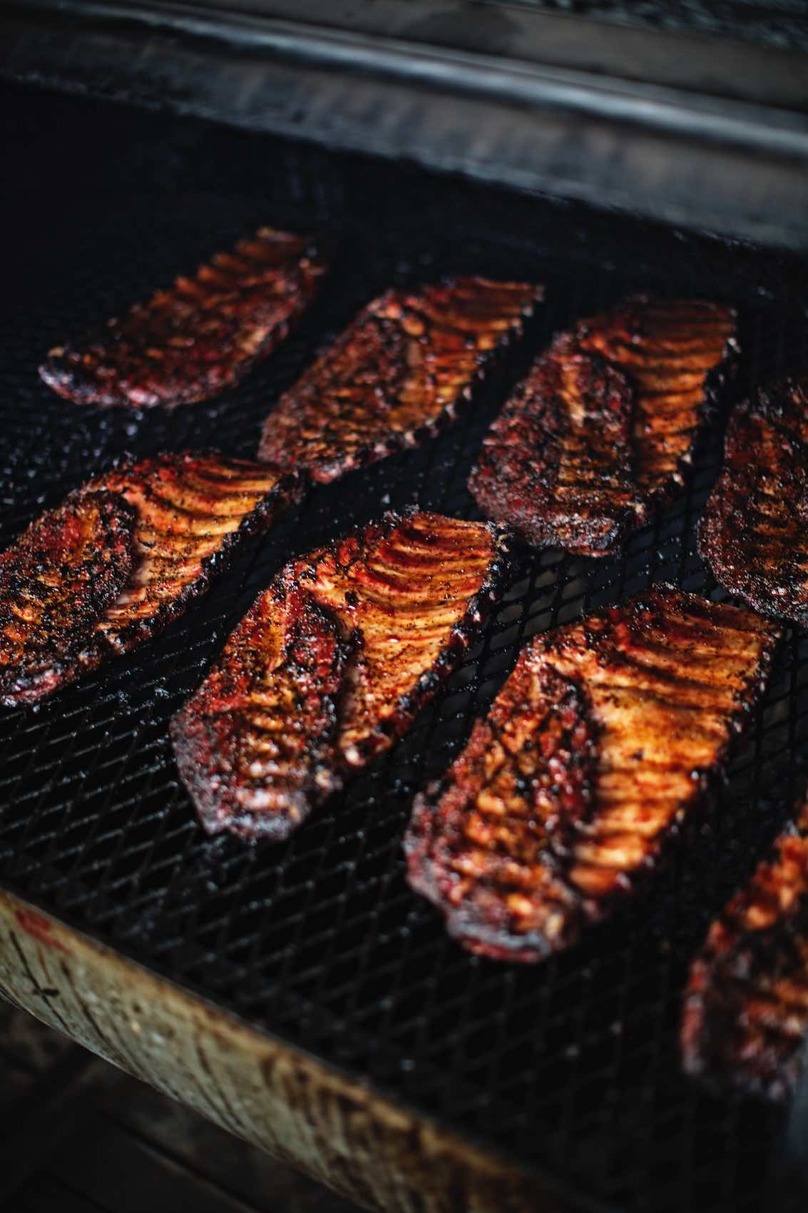 Jody Horton Photography - Barbecued ribs cooking in smoker.