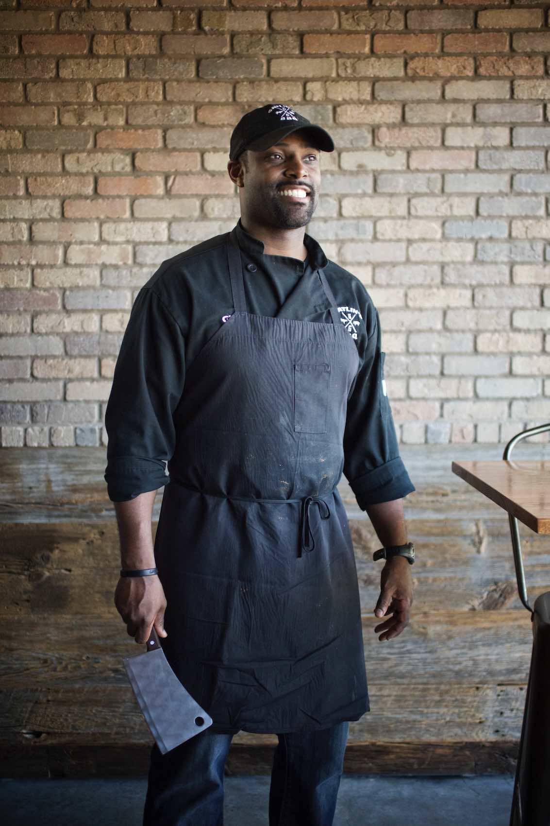 Jody Horton Photography - Chef in uniform holding a butcher