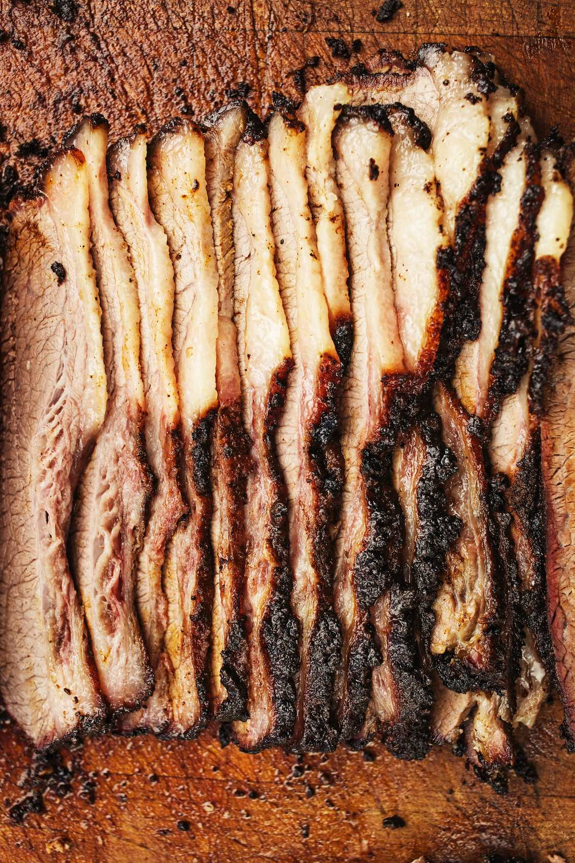 Jody Horton Photography - Sliced brisket on wood cutting board.