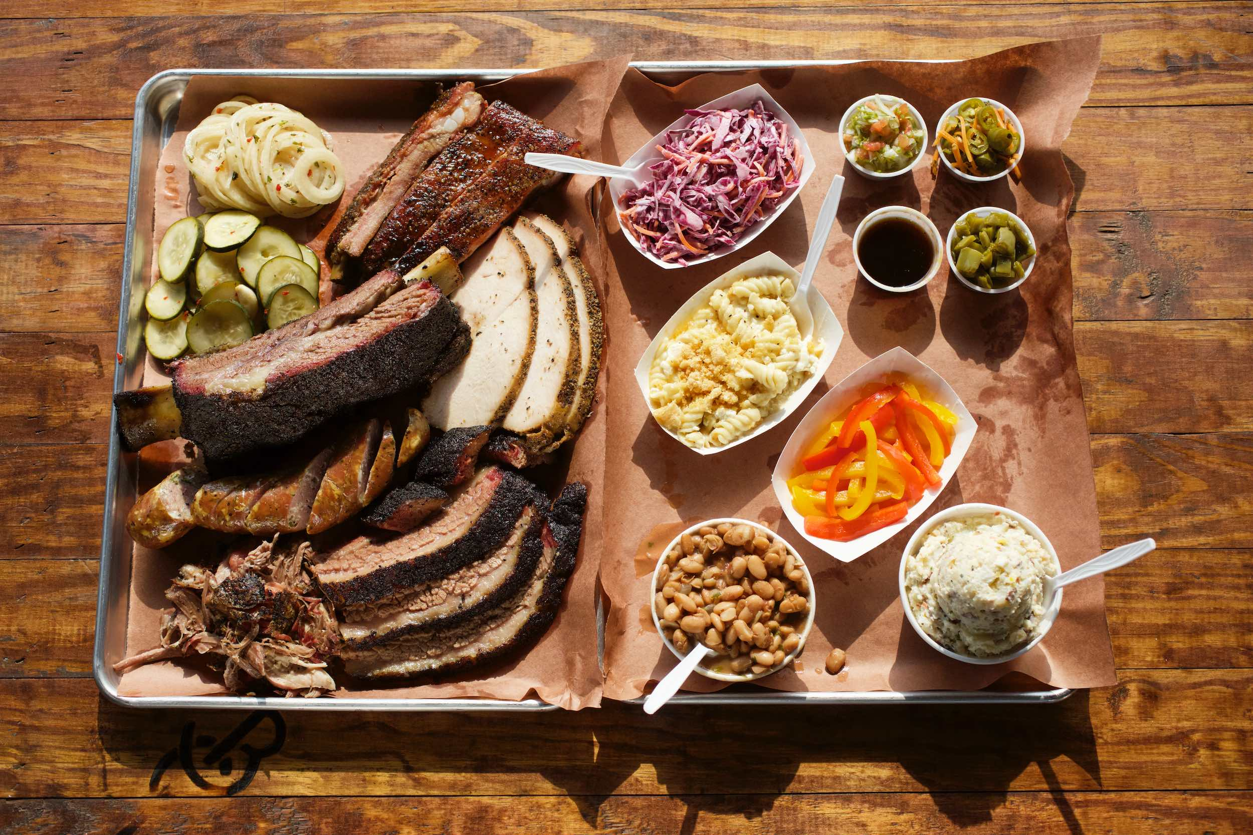 Jody Horton Photography - Barbecue spread on parchment on wood table.