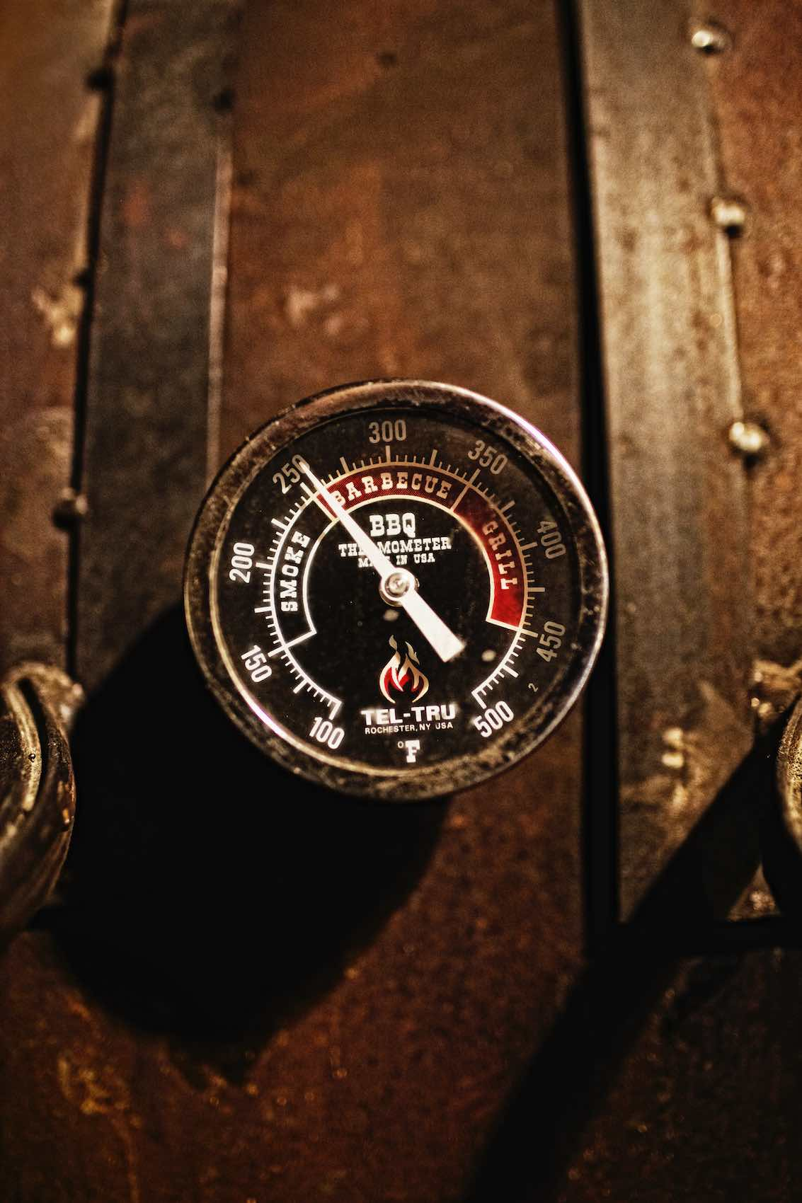 Jody Horton Photography -  Barbecue thermometer outside smoker.