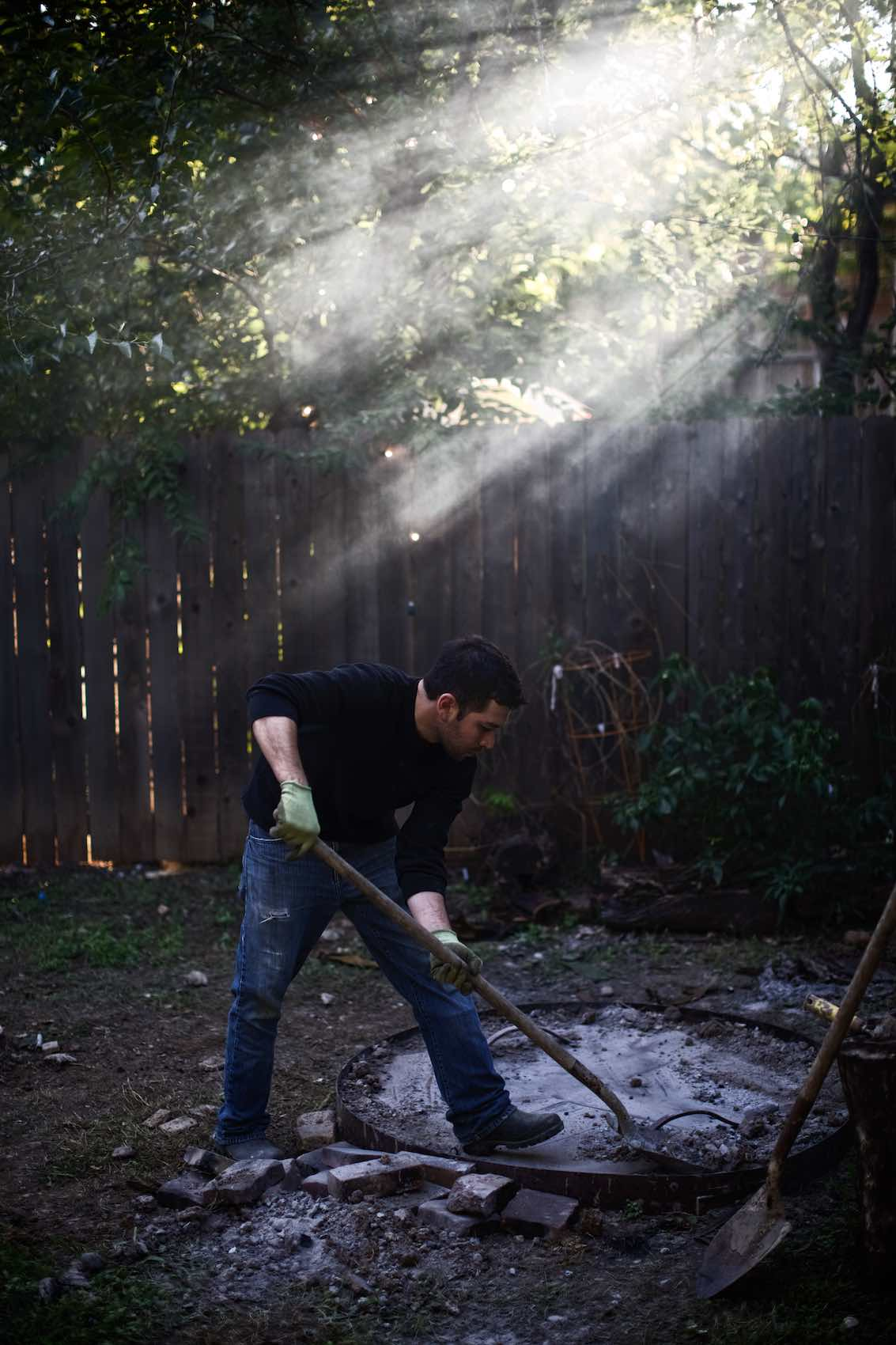 Jody Horton Photography - Shoveling charcoal outside.