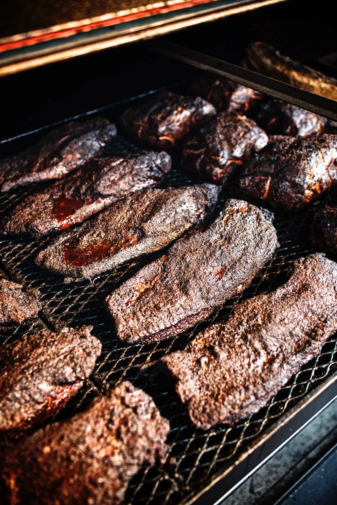 Jody Horton Photography - Barbecued meats cooking on grill.