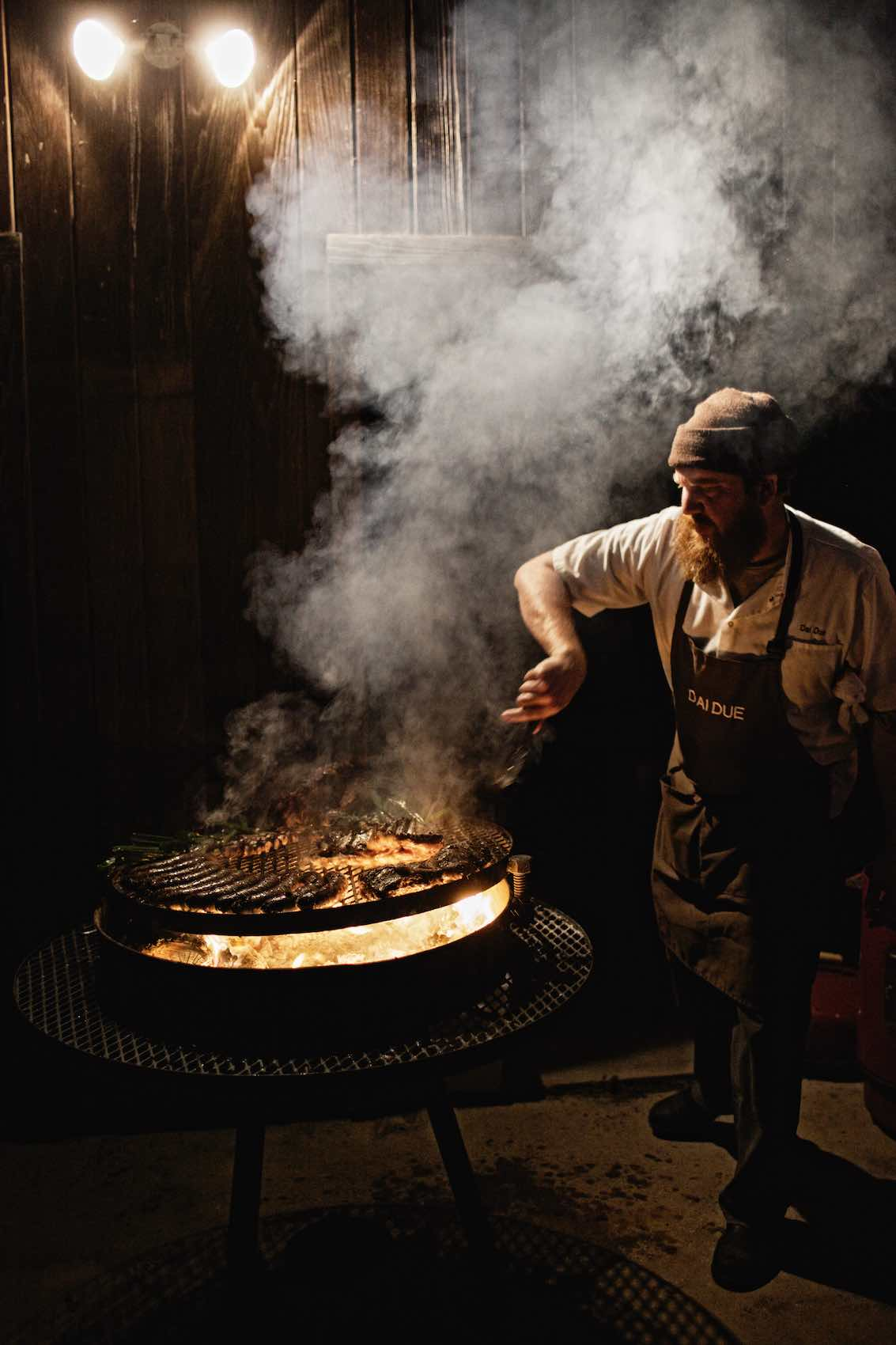 Jody Horton Photography - Chef Jesse Griffith cooking meats on outdoor grill.