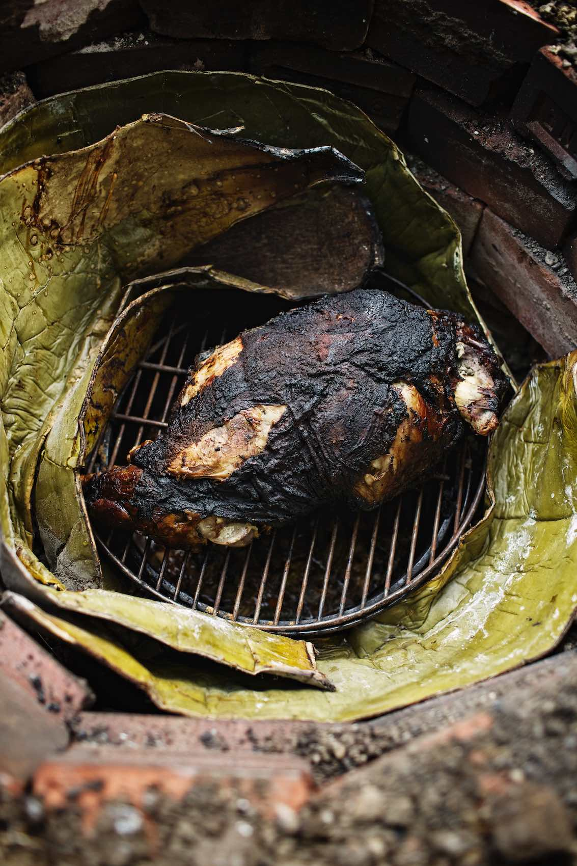 Jody Horton Photography - Meat cooked in leaved on grill.
