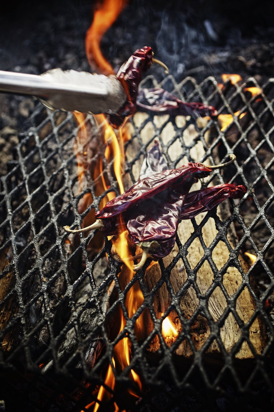 Jody Horton Photography - Chilies charring on a wood fire.