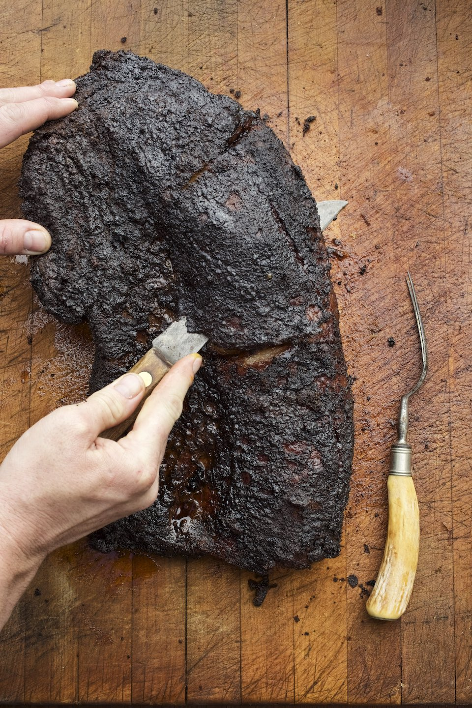 Jody Horton Photography - Barbecued brisket cut on a wood board.