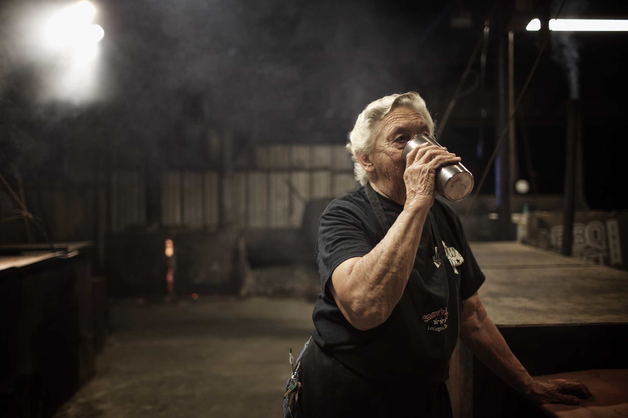 Jody Horton Photography - Pit master breaking for a refreshment in the barbecue pit.