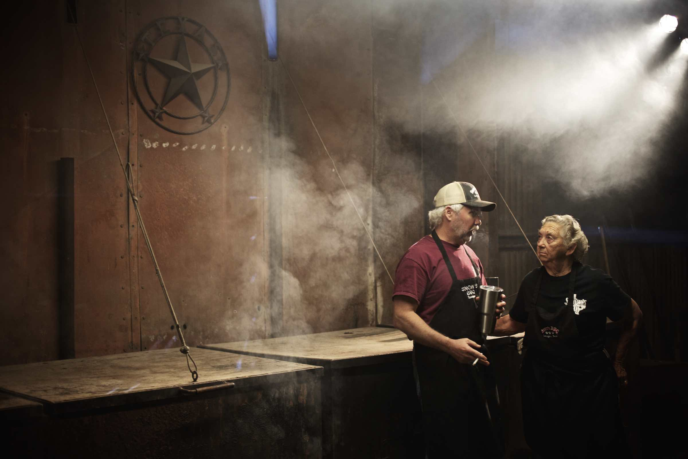 Jody Horton Photography - Pit masters chatting together in the barbecue pit.