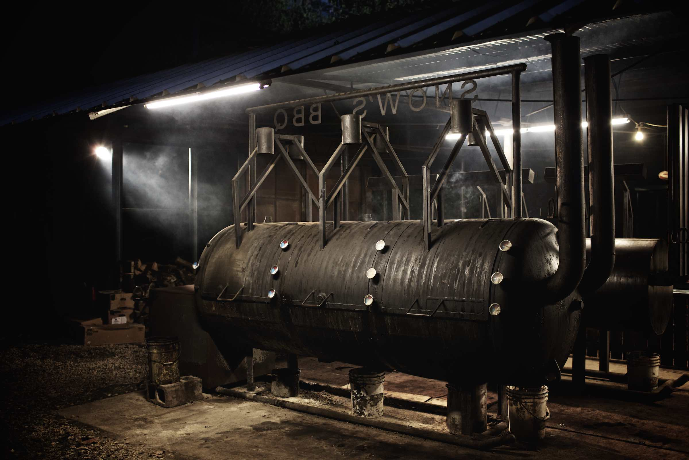 Jody Horton Photography - Large barbecue smokers underneath bright, florescnet lights.
