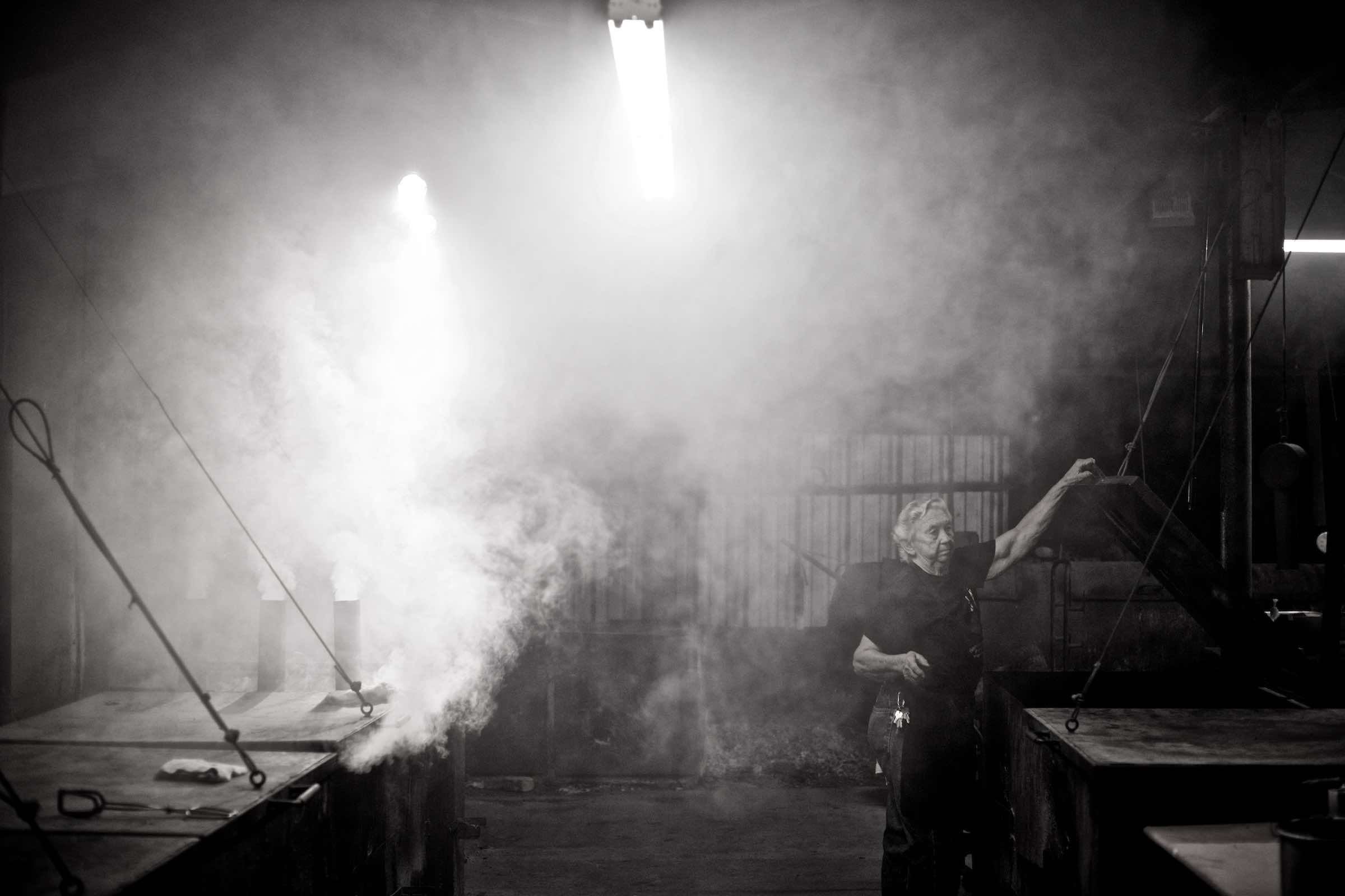 Jody Horton Photography - Pit master working in a smokey warehouse, shot in B&W.